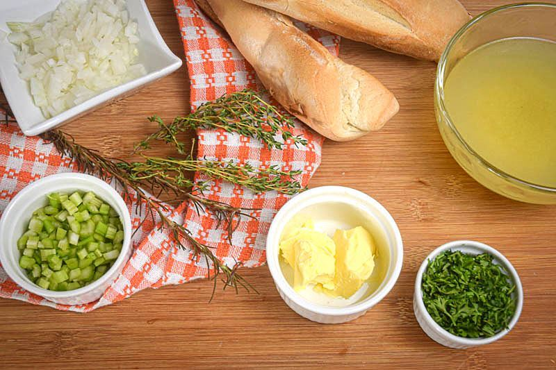 Stuffing ingredients laid out on a wooden background.