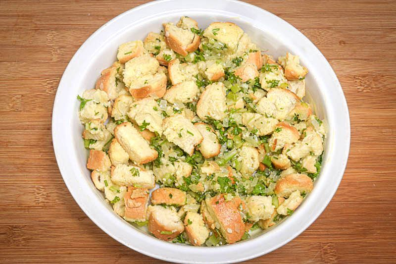 Stuffing in a bowl, wooden background.