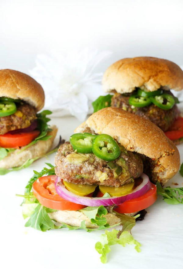 Avocado jalapeno burgers, white background with a white flower.