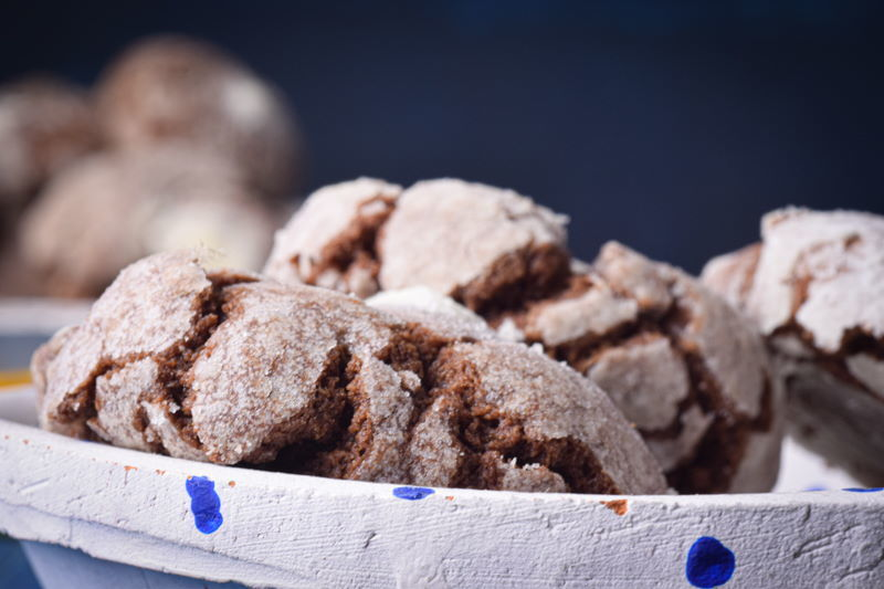 Chocolate crinkle cookies on a white plate.