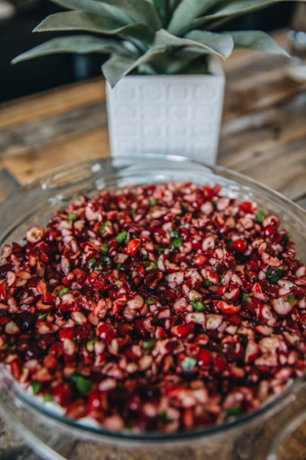 Cranberry jalapeno dip in a clear glass bowl.