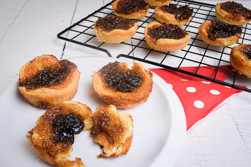 Butter tarts on a white plate and baking rack.