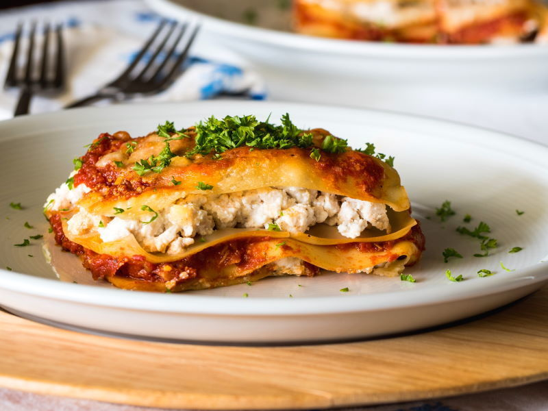 Piece of lasagna on a plate.