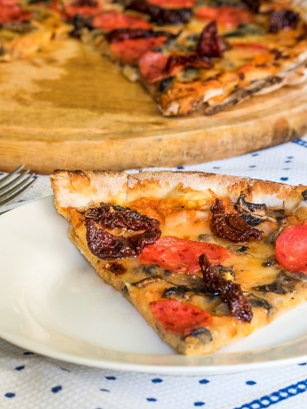 Pizza on a serving board.