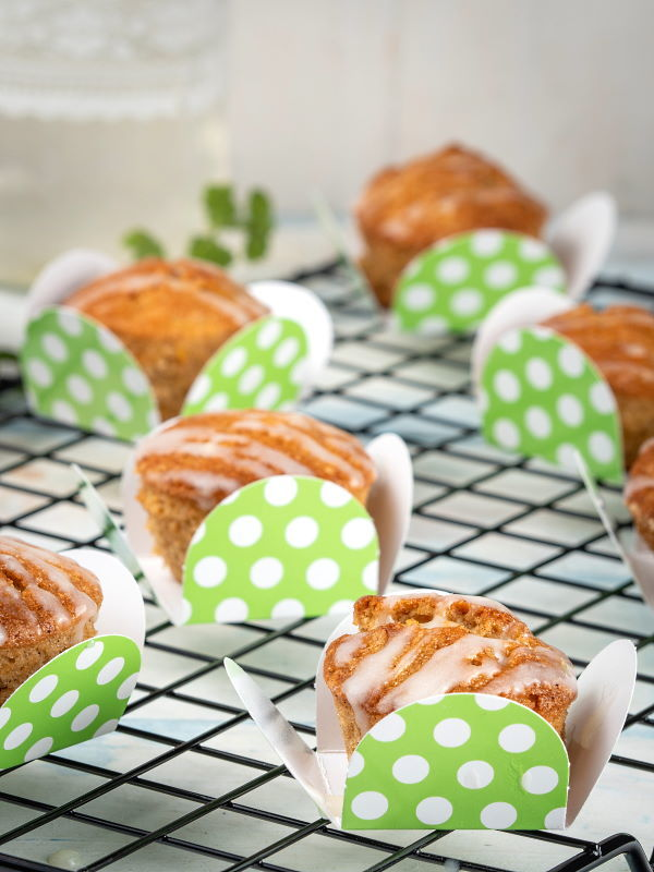 Gluten Free & Vegan Carrot Cupcakes on a wire rack and green polka dot packaging.