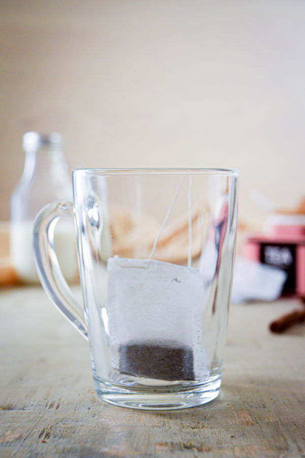 A clear glass mug with earl grey tea bag.