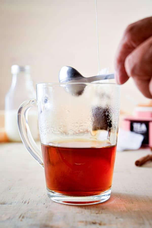 Earl grey tea steeped in a clear glass mug.