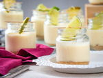 Iced lemon mousse in mini jars with lemon slices.
