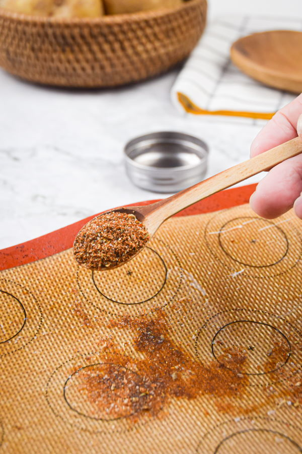 Cajun spices sprinkled over a greased silicone mat.