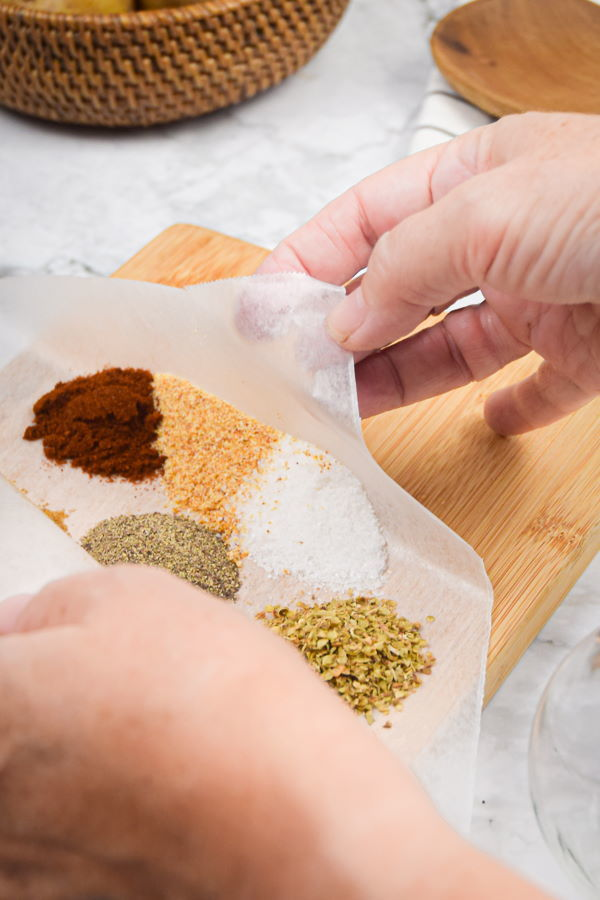 Cajun spices on a wax paper piece.