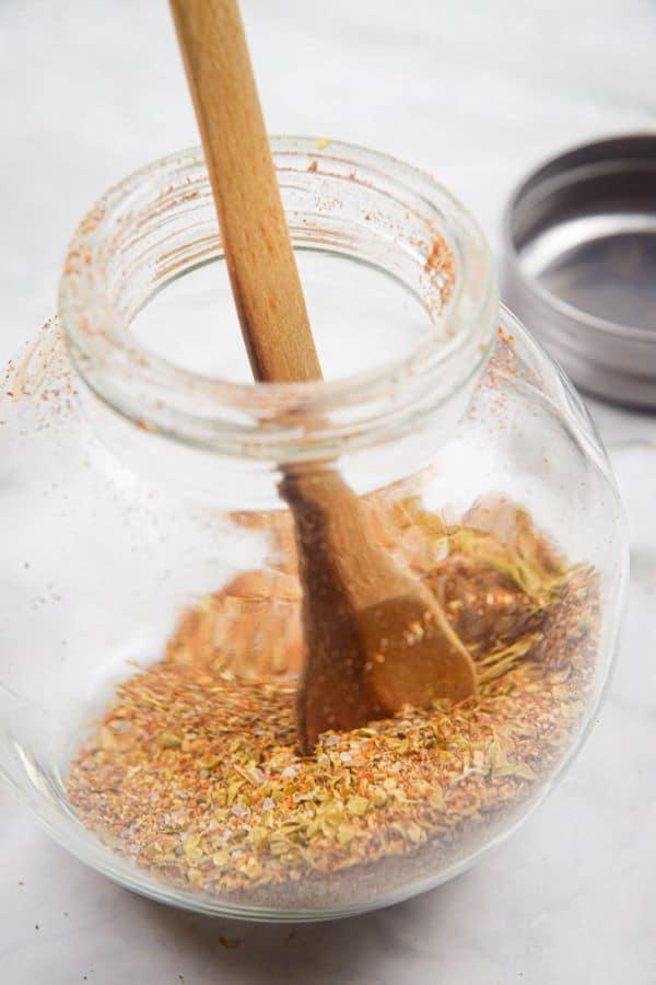 Cajun spices in a small glass spice jar.