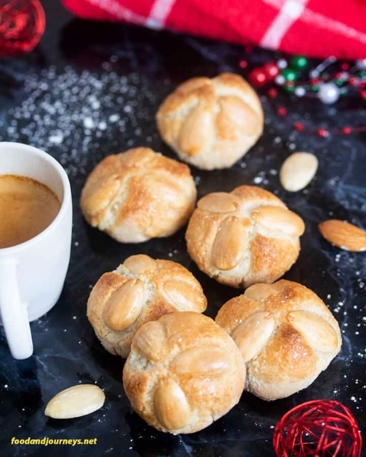 Marzipan bites with almonds and a coffee mug.
