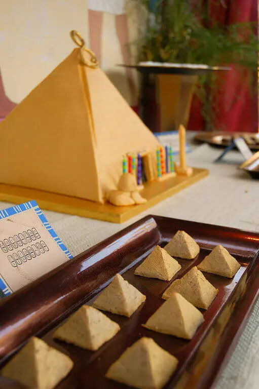 Marzipan pyramids on platter, pyramid decoration in background.