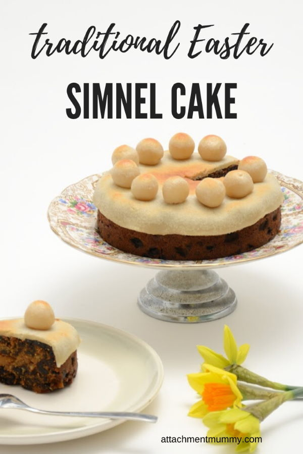 Simnel cake on a platter, white background.