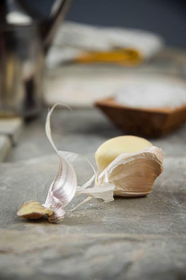 Garlic clove on stone background.
