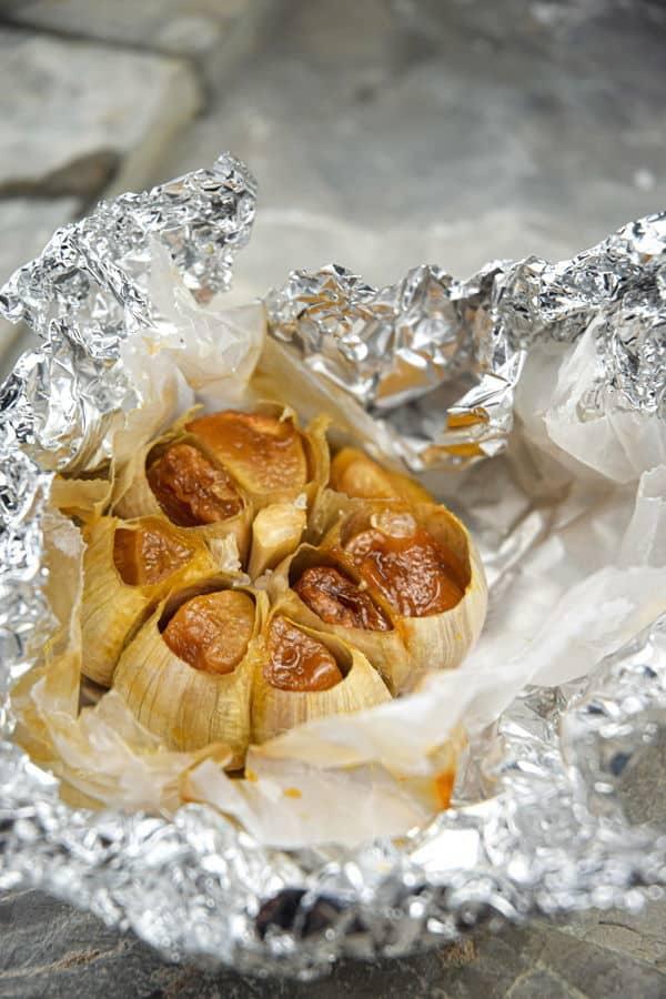 Roasted garlic head in foil.