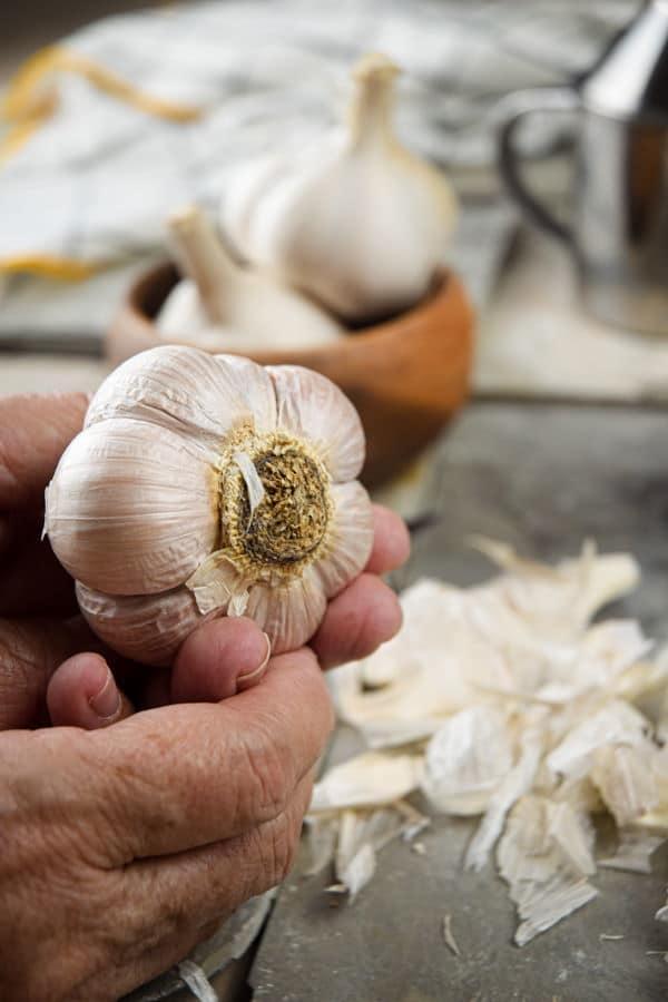 Fresh, peeled garlic head.