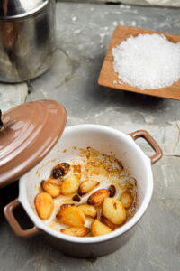 Roast garlic in a small baking dish, salt on the side.