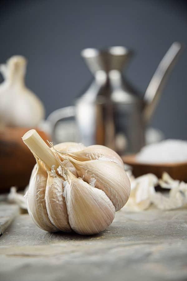 Fresh garlic head on stone.