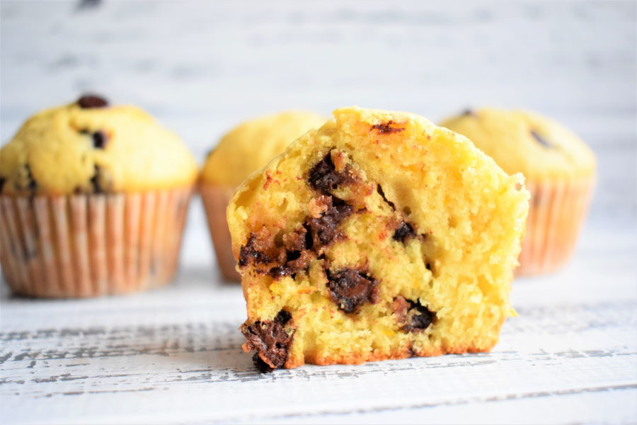 Chocolate Chip Orange Zest Muffins on white wooden background.