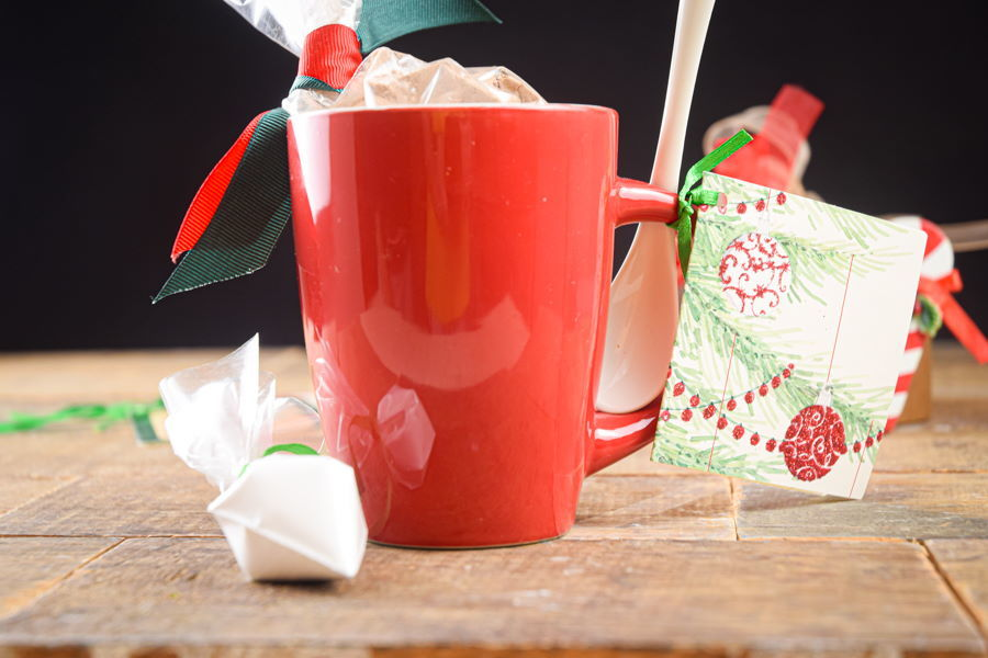 Chocolate cake ingredients in a red mug with Christmas decorations.