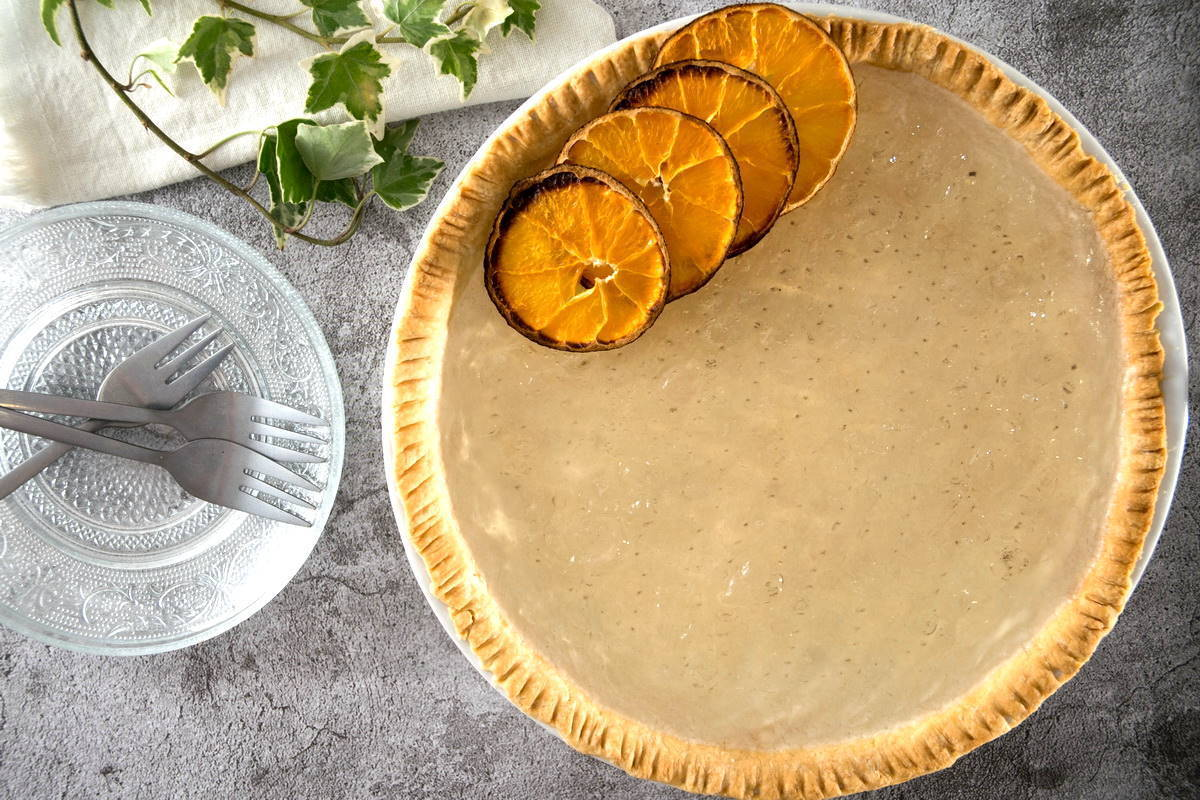 Clear pumpkin pie with dehydrated orange slices.