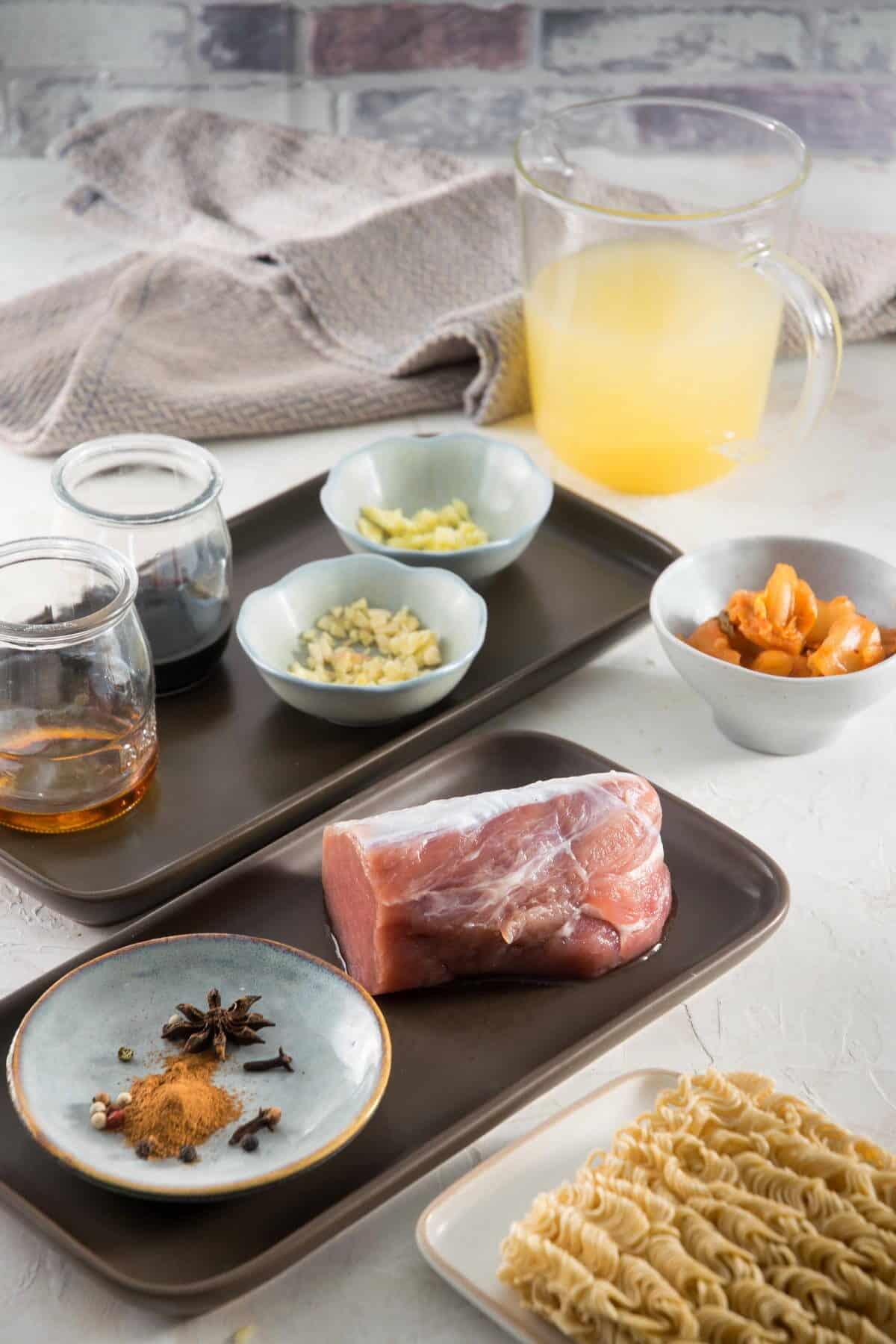 Kimchi ramen ingredients prepped on light background.