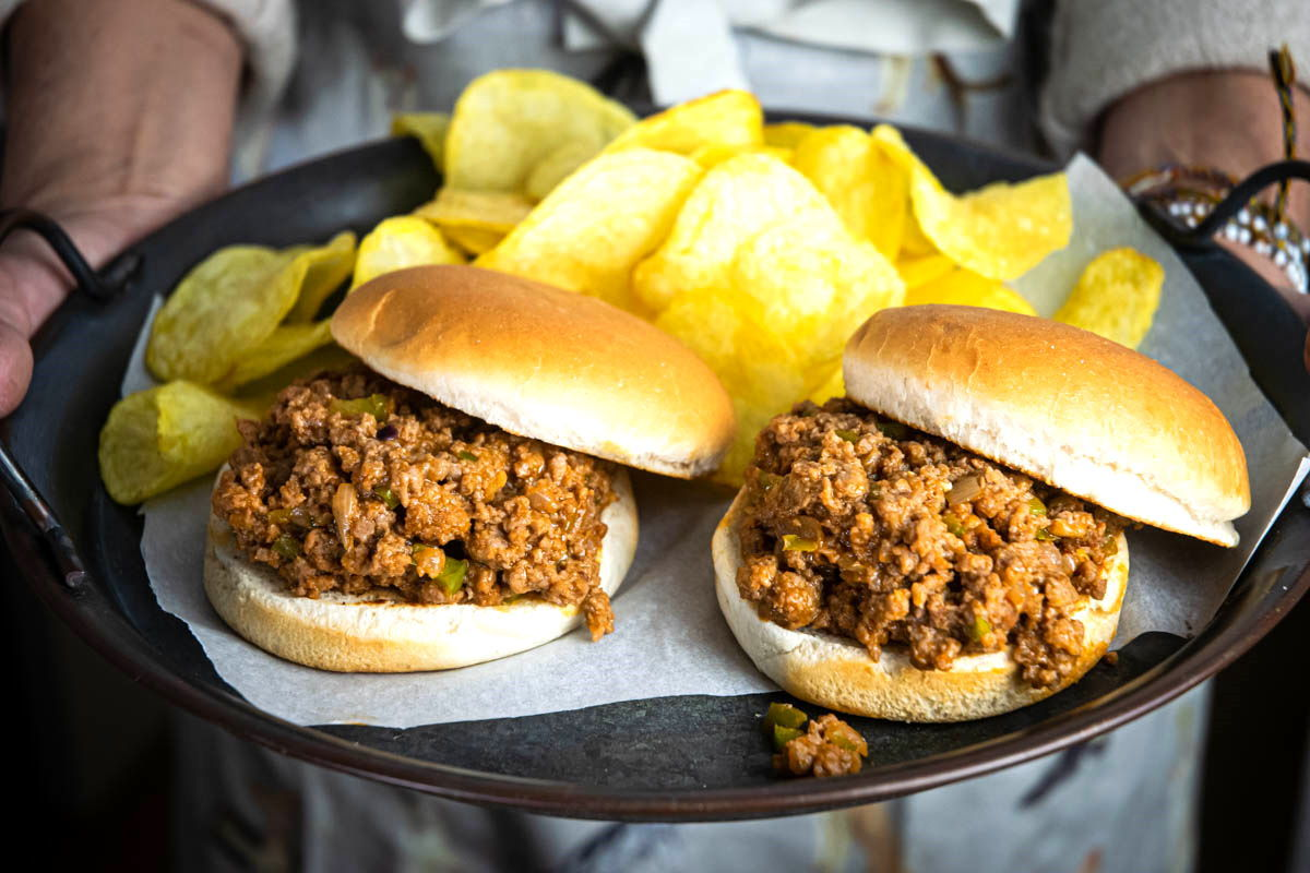 Sloppy Joes on a serving dish with chips.