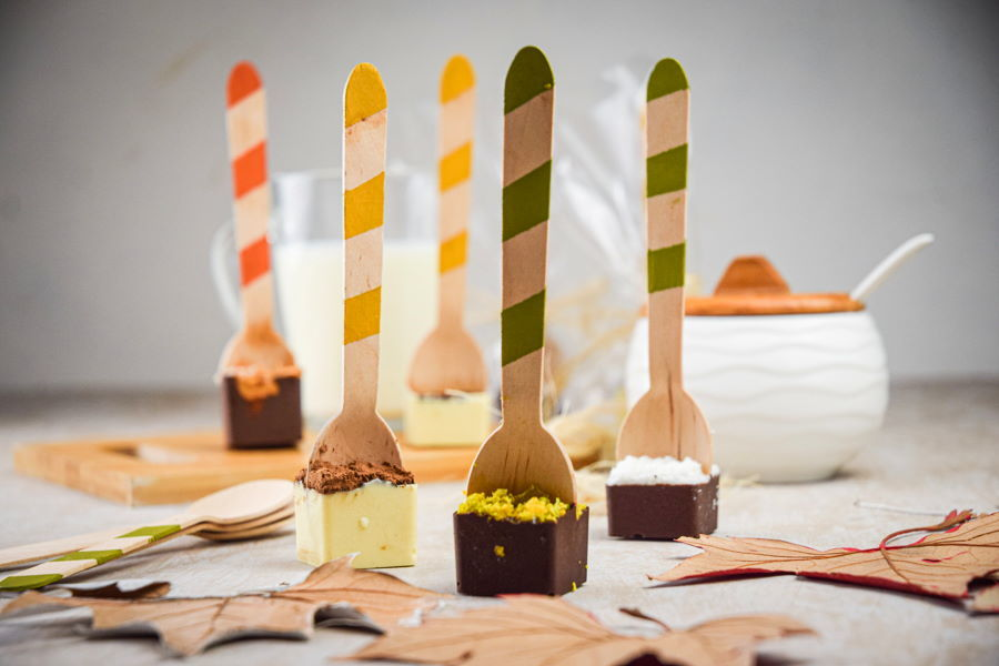 Hot chocolate spoons standing up on light background.