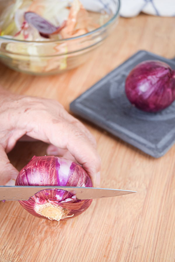 Sliced, red onion on wooden background.