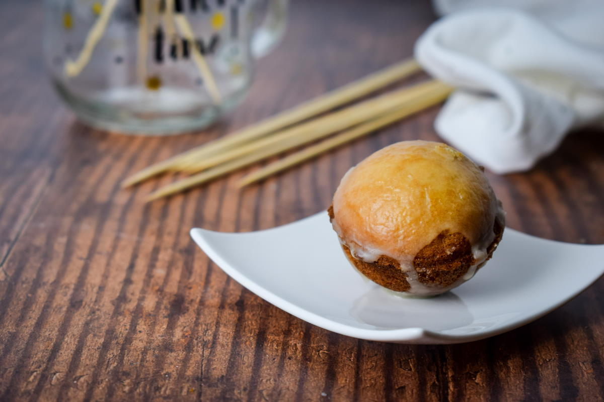 Glazed cake pop on a serving dish.