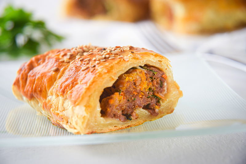Sausage roll on a plate.