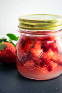Vodka strawberry infusion in a jar.