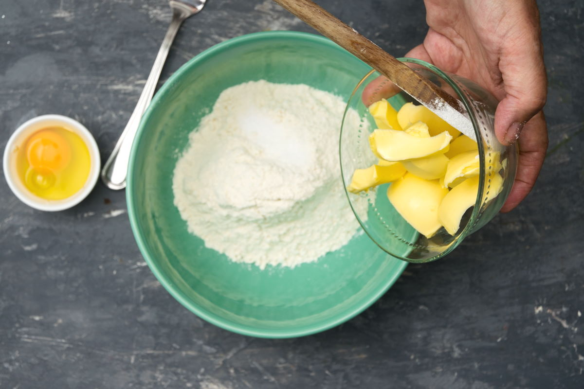 Flour and butter in a bowl.