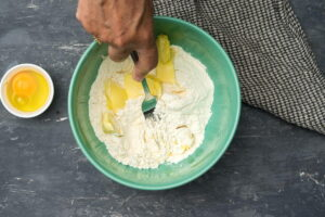 Flour and butter in a bowl with a fork.