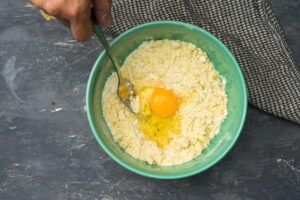 Flour and butter in a bowl with an egg.