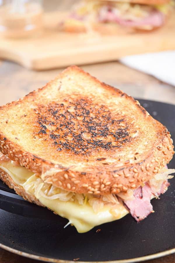 Reuben sandwich in a frying pan.