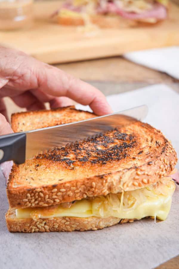 Reuben sandwich and a knife.