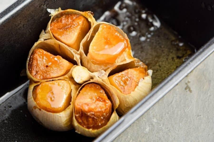 Roasted garlic in a pan.