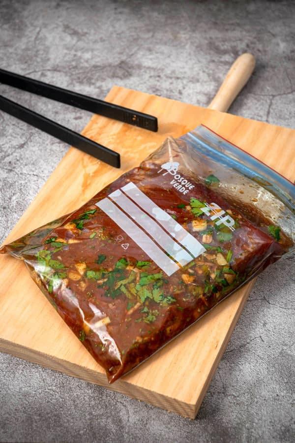 Flank steak and marinade in zip top bag.