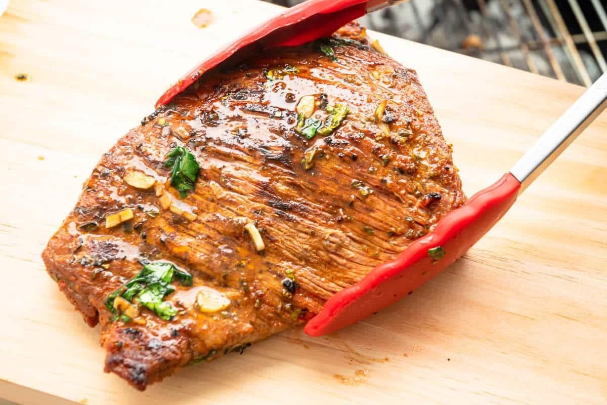 Carne asada on cutting board.