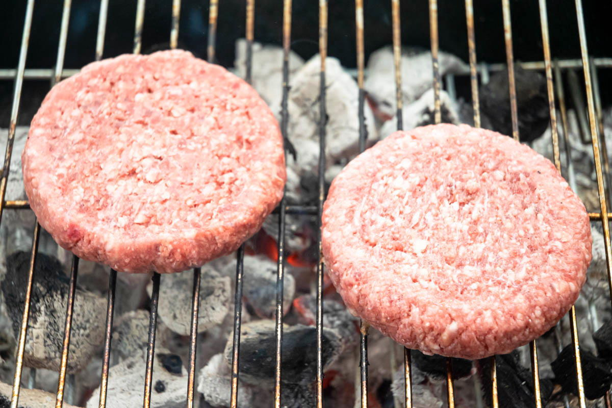 Burger patties on the grill.