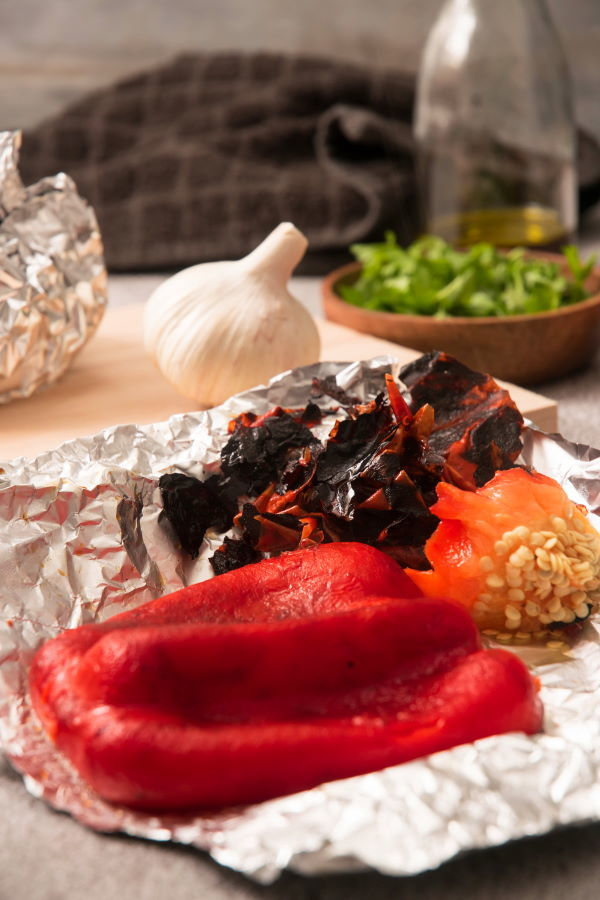 Grilled, skinned red bell pepper on foil.