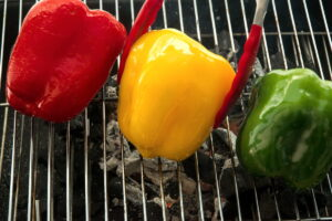 3 bell peppers on the grill.