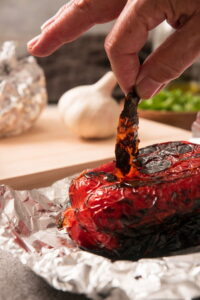 Grilled red bell pepper on foil.