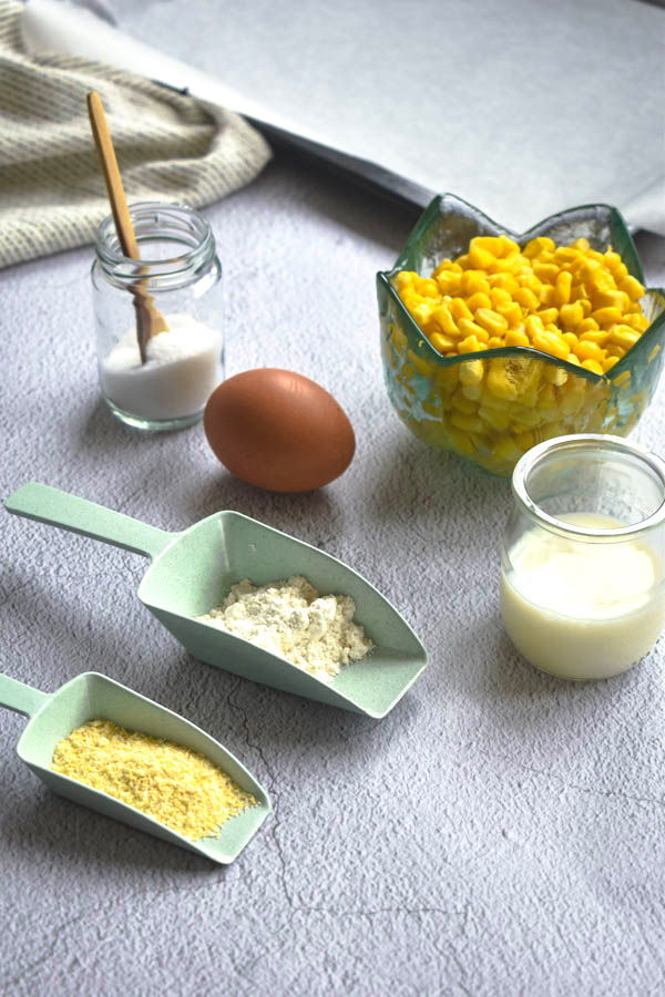 Corn nugget ingredients prepped on a light background.