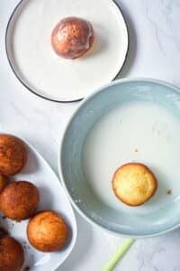 Margarita cake pops on white plates, marble background.