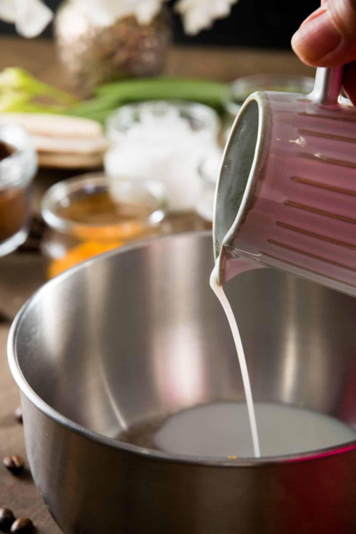 Milk pouring into a saucepan.