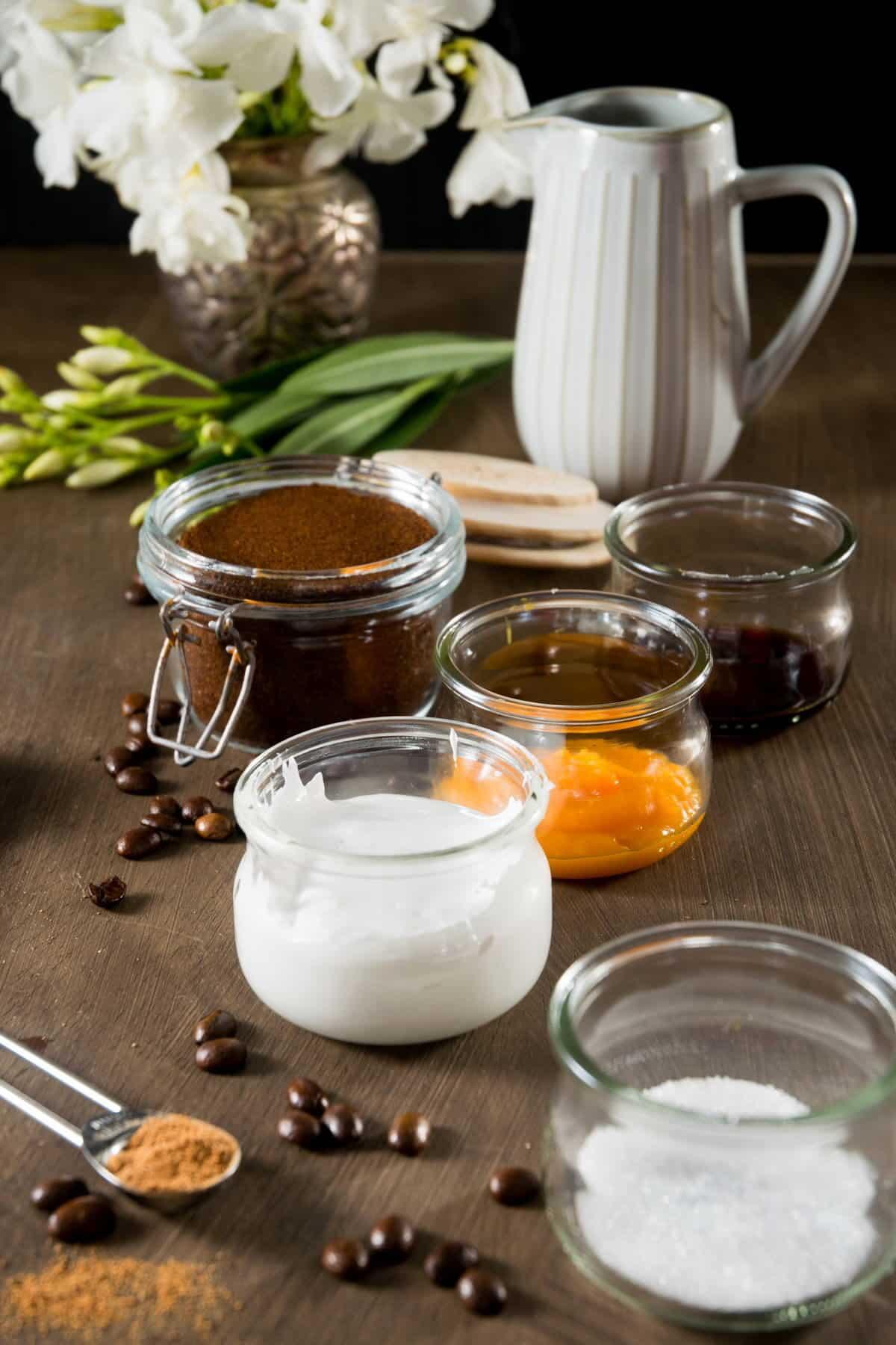 Marshmallow pumpkin latte ingredients on wood background.