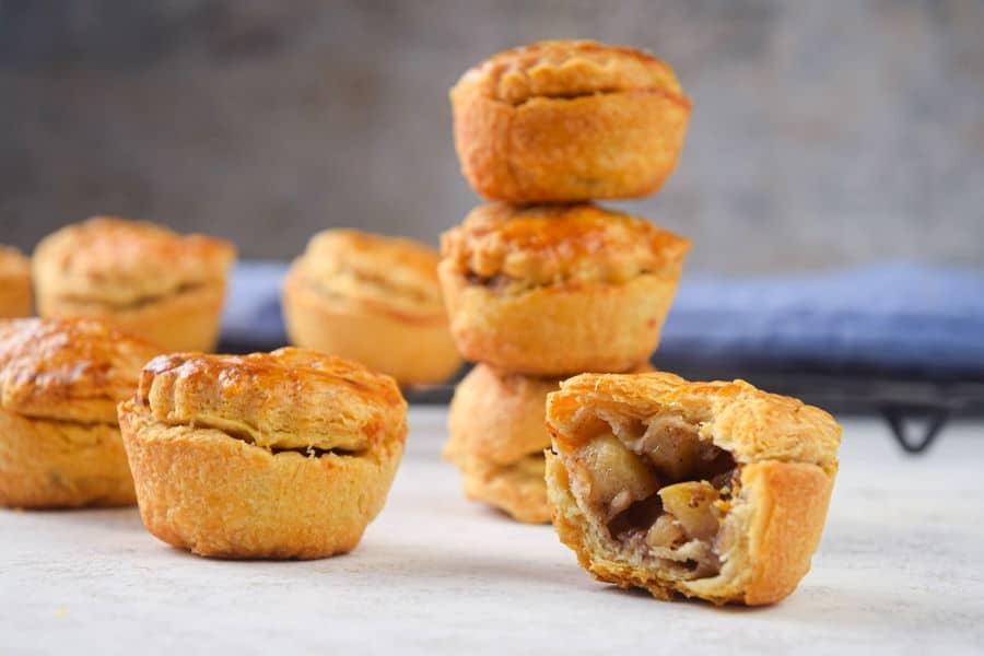 Mini apple pies stacked.